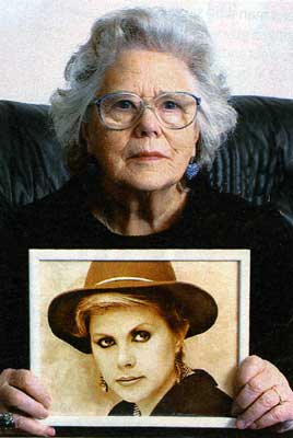 Jean MacColl with photo of Kirsty